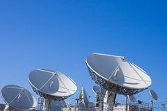 Uplink telecom facility dish. TV uplink - complex, large group of huge satellite dishes used for telecommunication network of american and european telecoms Royalty Free Stock Photography