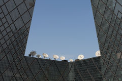 Uplink telecom facility dish. Group of huge satellite dishes used for telecommunication network on a building Stock Image