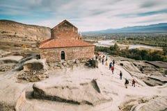 Uplistsikhe, regione di Shida Kartli, Georgia Uplis di visita della gente Fotografia Stock Libera da Diritti
