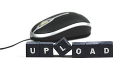 Upload. A mouse behind the word upload Royalty Free Stock Photo