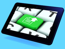 Upload Arrow And File Key Tablet Shows Uploaded Software or Data Royalty Free Stock Images