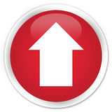 Upload arrow icon premium red round button Stock Photography