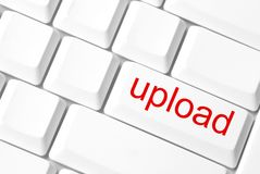 Upload button. Upload concept with white key-board Royalty Free Stock Image