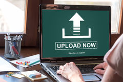 Upload concept on a laptop screen. Laptop screen displaying an upload concept Royalty Free Stock Images