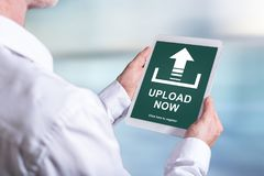 Upload concept on a tablet. Tablet screen displaying an upload concept Royalty Free Stock Photo