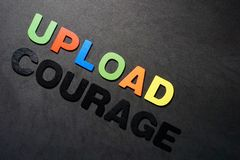 Upload courage. Word colorful letter text on black and grey background illustration creative type graphic message expression pedro jose pedryj royalty free stock images