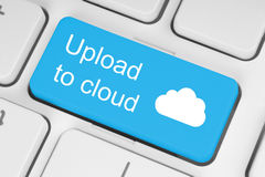 Upload to cloud concept. On blue keyboard button Royalty Free Stock Image