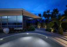 Upmarket house and pool at night Royalty Free Stock Images