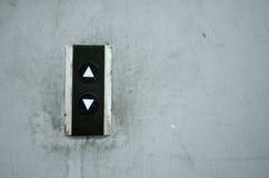 Uppåt- och neråt knappen och fläck på väggen. Fotografering för Bildbyråer