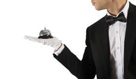 Uppassare med klockan i hand Begrepp av första klassservice i din affär royaltyfria bilder