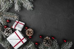 Upper, above, top view of pine, evergreen, and Christmas red glass toys, presents on stone background. Upper, above, top view of pine, evergreen, and Christmas stock photography