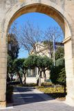 Upper Barrakka Gardens, Valletta. View through an archway towards the Upper Barrakka Gardens with the Stock Exchange to the rear, Valletta, Malta, Europe Stock Images