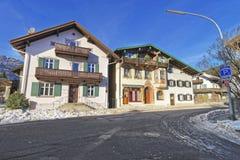 Upper Bavarian-styled houses in Garmisch-Partenkirchen with brig Royalty Free Stock Photo