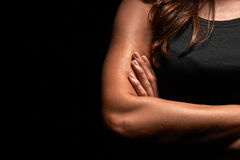 Upper body of a muscular woman. In a studio royalty free stock photo