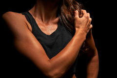 Upper body of a muscular woman Stock Photography