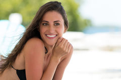 Beautiful smiling woman in a tropical beach Royalty Free Stock Images