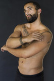 Upper body shot of a young bearded model Royalty Free Stock Images