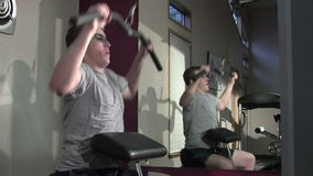 Upper body workout. Young man exercising his upper body stock footage