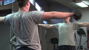 Upper body workout. Young man exercising his upper body stock video