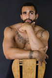 Upper body of a young bearded man Stock Images