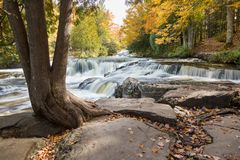 Upper Bond Falls in Autumn. Upper Peninsula of Michigan. The Ontonagon River flows over upper Bond Falls near Paulding Michigan in the Upper Peninsula. Autumn Stock Photography