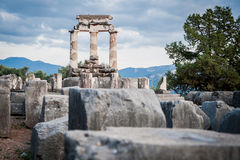 Upper Central Greece, August 2015, Delphi ancient sanctuary - The Delphic Tholos. Ancient ruinc, old religion cult place Royalty Free Stock Image