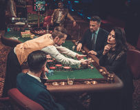 Upper class friends gambling in a casino.  Stock Photography