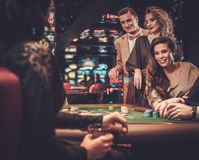 Upper class friends gambling in a casino.  royalty free stock photography