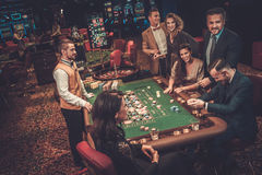 Upper class friends gambling in a casino.  Stock Images