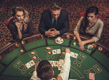 Upper class friends gambling in a casino.  royalty free stock photo