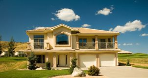 Upper class luxury home 1. Upper class luxury home with double garage, and deck.  Golf course in backyard Stock Photo
