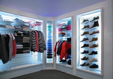 Upper clothes and shoes in shop Royalty Free Stock Image