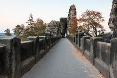 Upper course of the Bastei bridge with trees and rock formation in autumn mood with a view of rock gate royalty free stock images