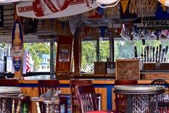 Upper deck bar at Captain Jacks at Sodus Point, New York. Upper deck bar overlooks the marina at Sodus Point, New York Captain Jacks Tavern. A warm sunny stock images