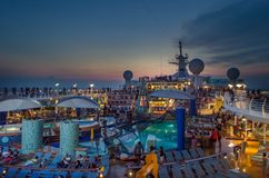 Upper deck of cruise liner Voyager with a pool stock images