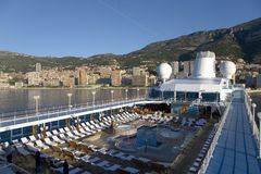 Upper deck swimming pool of Insignia Oceania Cruise ship as it cruises Mediterranean Ocean, Europe Royalty Free Stock Photo
