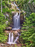 Upper Doyles River Falls in Shenandoah National Park. A long range view of the twin cascading falls that form Upper Doyles River Falls, located in off of Skyline Royalty Free Stock Photo
