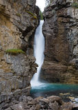 Upper Falls at Johnston Canyon. The Upper Waterfalls at Johnston Canyon in the Canadian Rocky Mountains stock photos