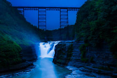 Upper Falls and a train bridge during twilight, at Letchworth State Park, NY. Royalty Free Stock Photo