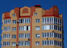 The upper floors of multistory building. Against the blue sky without clouds stock photography