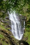 Water falling into midway pool at waterfall of Pistyll Rhaeadr in Wales stock photos