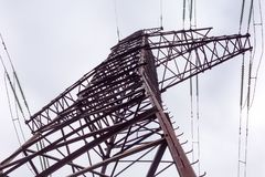Upper fragment of steel lattice transmission tower overhead power line. Fragment of the upper part steel lattice transmission tower overhead power line on royalty free stock photography