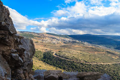 Upper Galilee mountains landscape framed by stones, rocks and ruins of ancient fortress, Israel view. Royalty Free Stock Photo