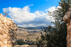 Upper Galilee mountains landscape framed by stones, rocks and ruins of ancient fortress, Israel view. Royalty Free Stock Image