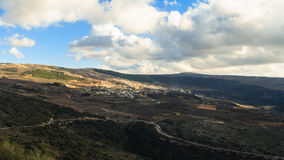 Upper Galilee mountains landscape. Golan Heights nature view from Nimrod, beautiful sunlight, blue sky with white clouds, druze village, Israel. Concept Royalty Free Stock Images