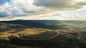 Upper Galilee mountains landscape. Golan Heights nature view from Nimrod, beautiful sunlight, blue sky with white clouds, druze village, Israel. Concept Stock Photo