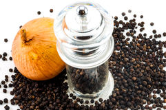 Upper of Glass pepper Grinder and fresh onion Stock Photo