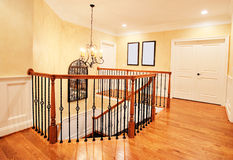 Upper Hallway and Staircase in Upscale Home. Interior of an upscale home, showing the upper hallway and top of the staircase. Horizontal format Royalty Free Stock Photos