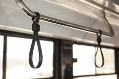 Upper handrail in bus. Bus handhold. black strap on the handrail in the bus. royalty free stock image