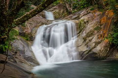 Upper Josephine Falls near Cairns. Queensland, Australia. The long-exposure shows the movement of water at the popular tourist attraction Royalty Free Stock Images